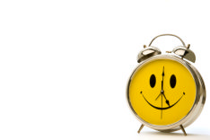 photo shows clock with smiling face